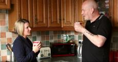 Sharine Burgess having a cup a tea with a serious injury client visiting him at home