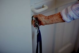 elderly resident closing door in care home