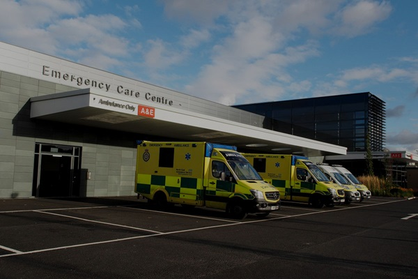 hospital exterior and parked ambulances