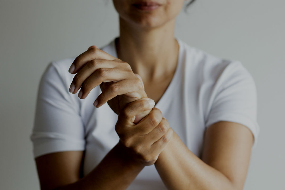 woman holding her wrist after a nerve injury