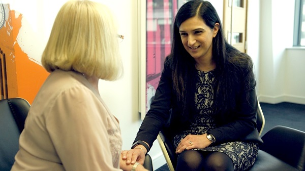 Kashmir Uppal, Medical negligence solicitor holding hand of Ian Paterson patient, an Shoosmiths client